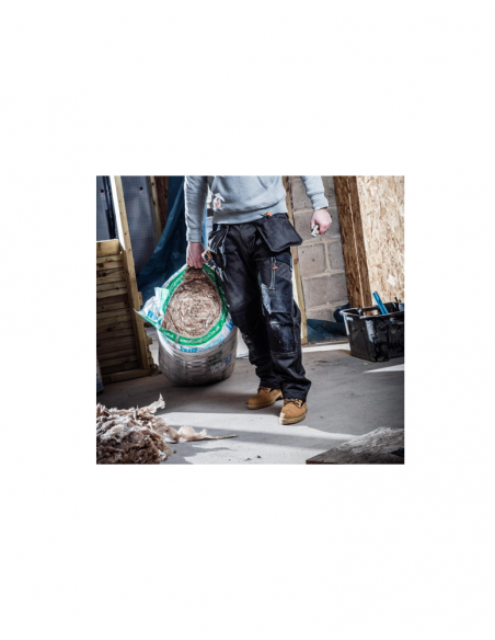 Scruffs 3D Trade Trousers (Graphite) in use by tradesman